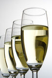 fyra exponeringsglas vit wine Royaltyfri Fotografi