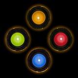 Fyra färgar av stearinljus Arkivfoton