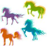 Fyra färgrika hästar Arkivbilder