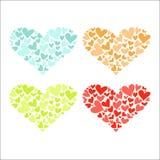 Fyra färgrika hjärtor Royaltyfria Bilder