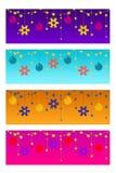 Fyra färgrika jultitelrader arkivbild