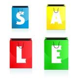 Fyra färgrika shoppingpåsar uthärda försäljningen Royaltyfri Bild