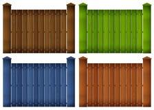 Fyra färgrika trästaket Arkivfoton
