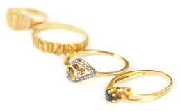 Fyra förlovningsringar Arkivbild