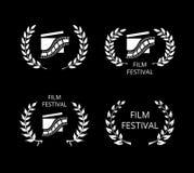 Fyra filmfestivalsymboler och logoer på svart Royaltyfri Fotografi