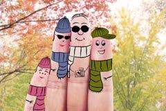 Fyra fingrar med höstkläder Royaltyfria Bilder