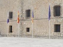 Fyra flaggor av Spanien och EU Arkivbild