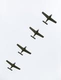 Fyra flygplan i bildande på airshow Royaltyfria Bilder