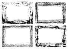 fyra grungeramar som isoleras på vit Arkivfoton