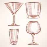Fyra hand-drog alkoholexponeringsglas Royaltyfri Foto