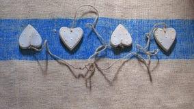 Fyra hjärtor som anknytas samman med rep Royaltyfri Bild