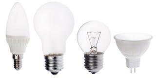 Fyra isolerade olika elektriska lampor på vit Arkivfoto