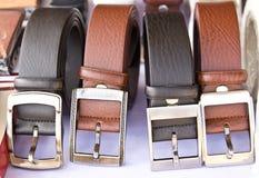 Fyra läderbälten Royaltyfria Bilder