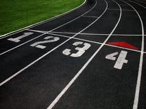 fyra lanes som kör spåret Fotografering för Bildbyråer