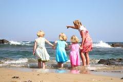 fyra lyckliga flickor Arkivfoto