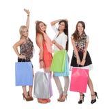 Fyra lyckliga kvinnligshoppare Royaltyfria Bilder