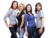 fyra lyckliga le kvinnor för grupp Royaltyfri Bild