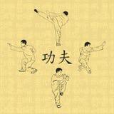 Fyra män är förlovade i kung fu Arkivbild