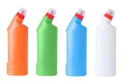 Fyra mång--färgad flaska vit isolat royaltyfri fotografi
