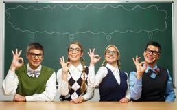 Fyra nerds säger ok Royaltyfri Bild