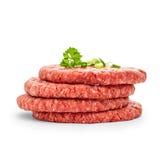 Fyra nya hamburgareskivor som isoleras Royaltyfri Foto