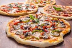 Fyra olika pizza Arkivbild