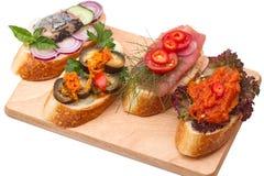 Fyra olika smörgåsar Arkivfoto