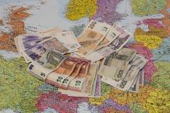 Fyra olika valutor som läggas ut på Europa Royaltyfria Bilder