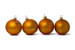 fyra orange prydnadar arkivfoto