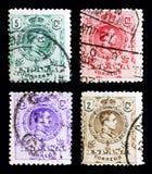 Fyra portostämplar från serie för konung Alfonso XIII, Spanien, circa 1 Arkivbild