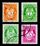 Fyra portostämplar som skrivs ut i Norge från serie för stolpehorn (1910 Arkivfoton
