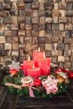Fyra röda Adventstearinljus Royaltyfria Bilder
