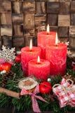 Fyra röda Adventstearinljus Royaltyfri Bild