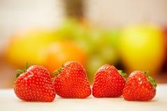 fyra röda jordgubbar Fotografering för Bildbyråer