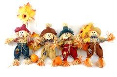 fyra scarecrows Arkivbilder