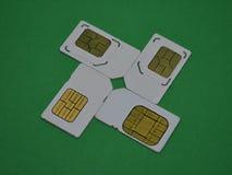 Fyra SIM-kort för mobiltelefoner Arkivfoton
