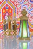 Fyra skinande lyktor över Ramadan Fabric Arkivfoton