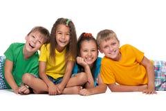 Fyra skratta barn Royaltyfria Bilder
