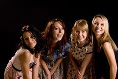 Fyra skratta tonåringar som har gyckel Royaltyfria Bilder