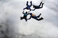 fyra skydivers Arkivbild