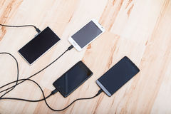 Fyra smartphones Royaltyfri Fotografi