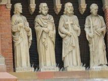 Fyra statyer av helgon Royaltyfri Bild