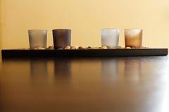 Fyra stearinljus på stenar Royaltyfri Foto