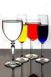 Fyra stemmed exponeringsglas Royaltyfria Bilder