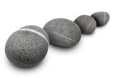 fyra stenar Arkivbild