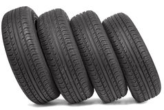 Fyra svarta gummihjul Arkivfoto