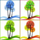 Fyra symboler med träd Sommar nedgång, vinter, vår Royaltyfria Foton