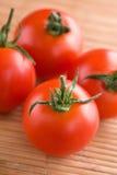 fyra tomater Arkivbilder