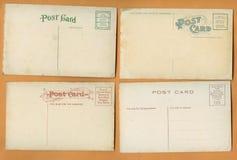 Fyra tomma gamla vykort Arkivbild