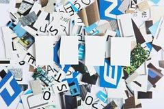 Fyra tomma utrymmen för bokstäver Royaltyfria Bilder